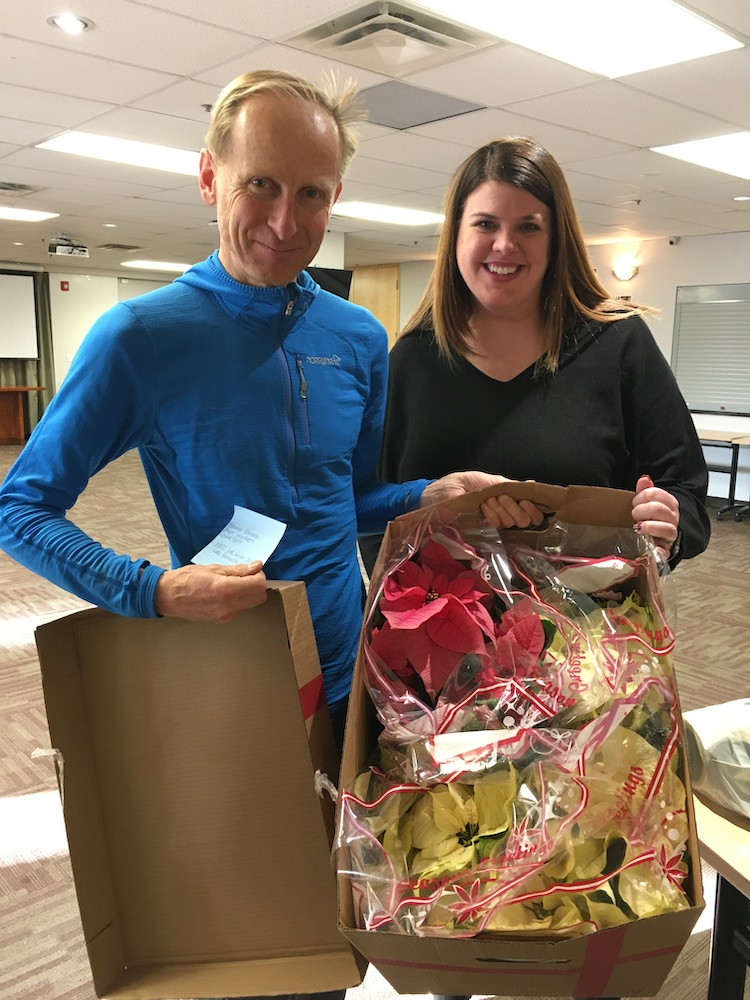 St. Andrew's Poinsettia deliveries: Andrew Stiles and Hillary Van Spronsen